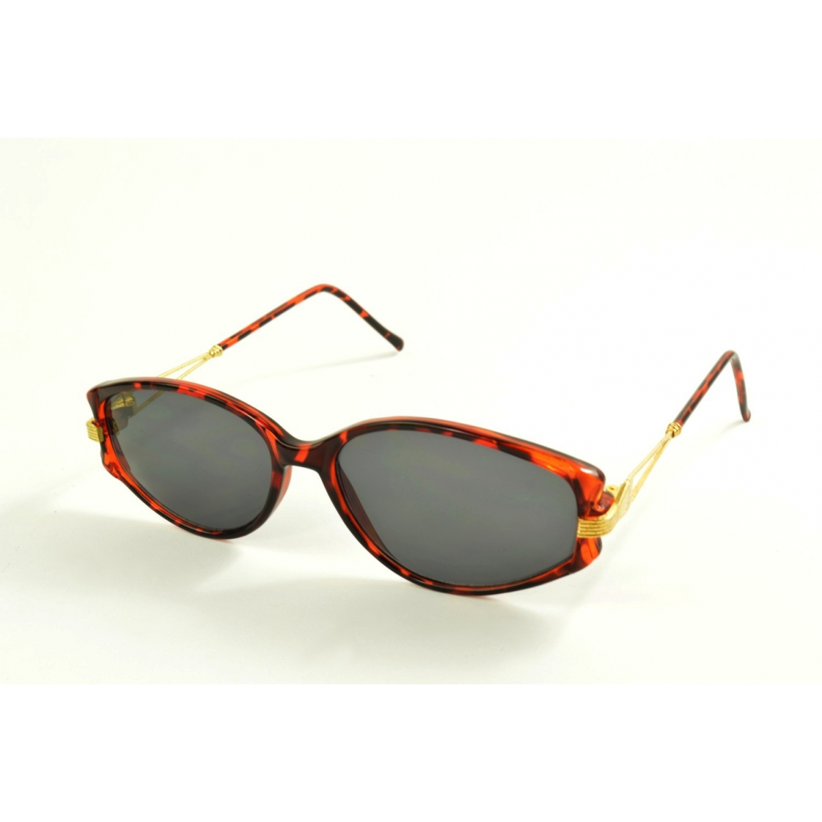 Oval sunglasses with golden metal and plastic tortoiseshell temples